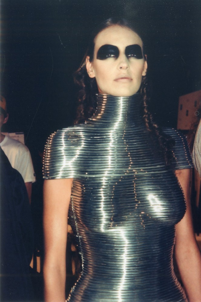 Backstage at the Alexander McQueen 'Black' show, June 2004. Aluminium Coiled Corset by Shaun Leane for Alexander McQueen, The Overlook, Autumn/Winter 1999. Courtesy of the Shaun Leane archive.